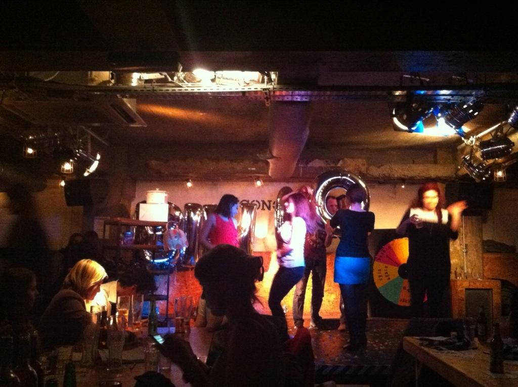 People dancing on the bingo stage